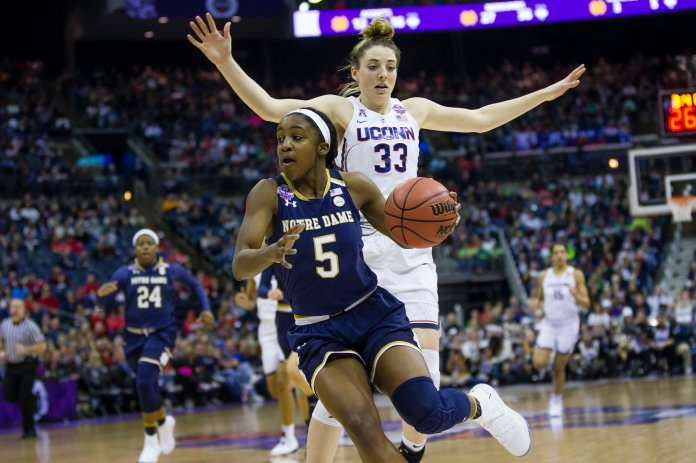 Notre Dame's Jackie Young (5) gets past Connecticut's Katie Lou Samuelson (33) during the semifinals of the women's NCAA Final Four college basketball tournament, Friday, March 30, 2018, in Columbus, Ohio. Notre Dame won in overtime 91-89. (Michael Caterina /South Bend Tribune via AP)