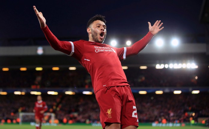 Liverpool's Alex Oxlade-Chamberlain celebrates after scoring his side's second goal of the game during the Champions League quarter final, first leg soccer match between Liverpool and Manchester City at Anfield, Liverpool, England, Wednesday, April 4, 2018. (Peter Byrne/PA via AP)