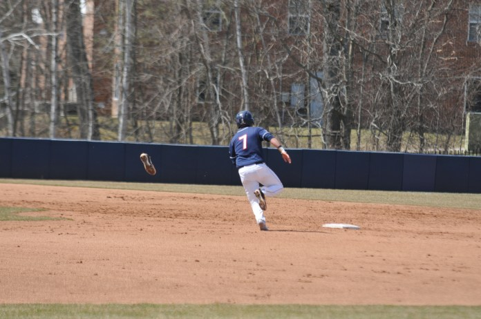 Christian Fedko (7) rounds the bases, minus a cleat, against the Knights (Jon Sammis/The Daily Campus)