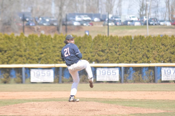 UConn ace Mason Feole (21) delivers in the series opener (Jon Sammis/The Daily Campus)