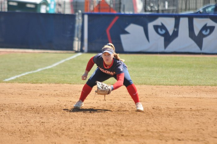Carli Cutler gets down and ready to make a play at Burrill Family Field (Jon Sammis/The Daily Campus)