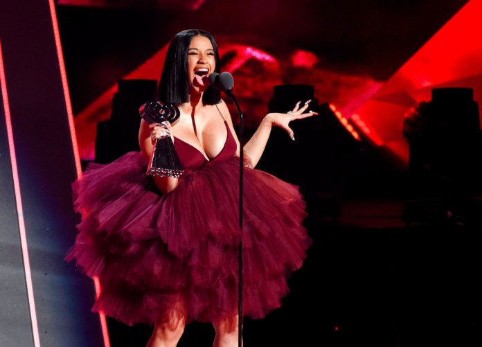 """In this March 11, 2018, file photo, Singer Cardi B accepts the Best New Artist award during the 2018 iHeartRadio Music Awards at The Forum in Inglewood, Calif. Cardi B has revealed during a """"Saturday Night Live"""" performance she's pregnant. Cardi B's debut album was released Friday, April 6. """"Invasion of Privacy"""" is set for a No. 1 Billboard debut. (Photo by Chris Pizzello/Invision/AP, File)"""