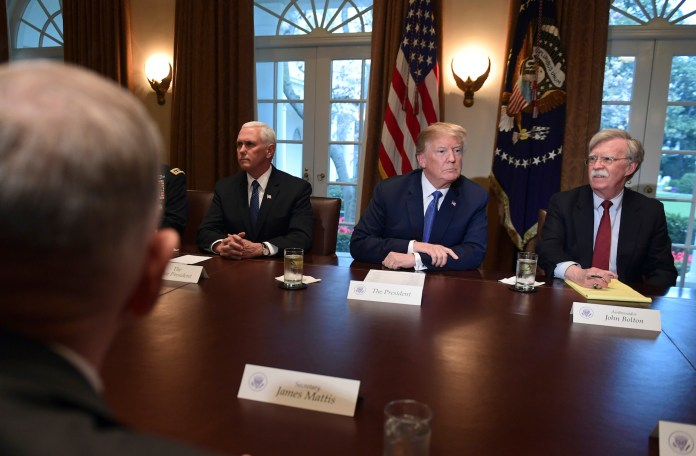 President Donald Trump, second from right, speaks in the Cabinet Room of the White House in Washington, Monday, April 9, 2018, at the start of a meeting with military leaders, with Defense Secretary Jim Mattis, left, Vice President Mike Pence and national security adviser John Bolton. (Susan Walsh/AP)