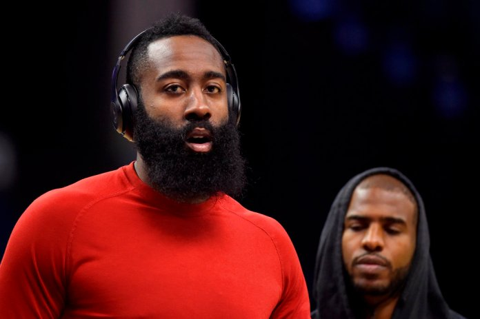 In this Nov. 18, 2017 photo, Houston Rockets guards James Harden, left, and Chris Paul warm up before and NBA basketball game against the Memphis Grizzlies in Memphis, Tenn. ((AP Photo/Brandon Dill)