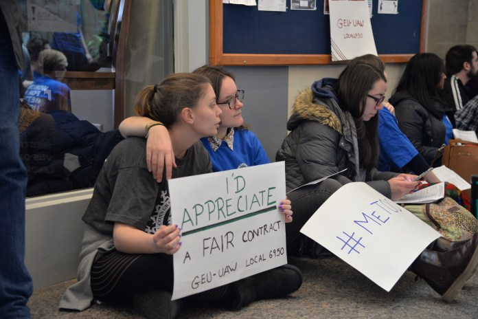 UConn graduate students sit-in the student union in protest of their current contracts on March 29, 2018. (Amar Batra/The Daily Campus)