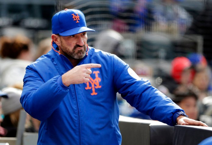 New York Mets manager Mickey Callaway signals to a player during the fourth inning of the baseball game against the Philadelphia Phillies at Citi Field, Wednesday, April 4, 2018, in New York. (AP Photo/Seth Wenig)