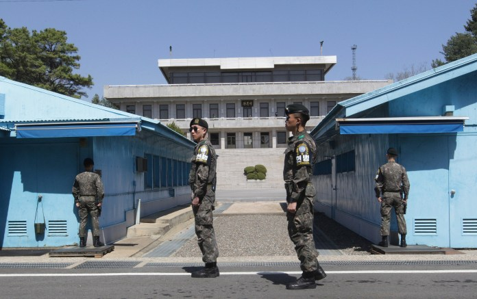 South Korean army soldiers stand guard at the border villages of Panmunjom in Paju, South Korea, Wednesday, April 11, 2018. North Korea's parliament was scheduled to convene on Wednesday amid a series of diplomatic moves by leader Kim Jong Un that could have a major impact on the direction the country takes in the months and possibly years ahead. (AP Photo/Ahn Young-joon)
