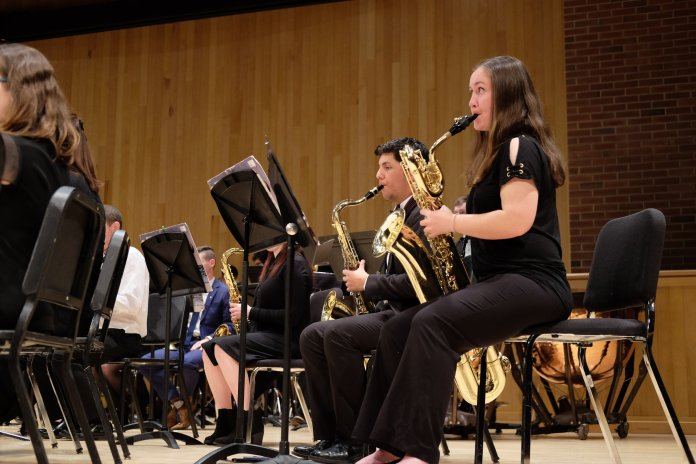 The symphonic band performs in the Von Der Mahen performance hall on Tuesday, Apr. 17. (Jon Sammis/The Daily Campus)