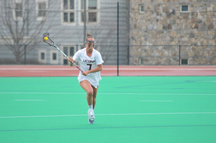 UConn's Women's Lacrosse team takes to the field against Cincinnati on Friday, Apr. 13. The Huskies played ruthlessly, dominating the Bearcats 20-8 (Jon Sammis/The Daily Campus)