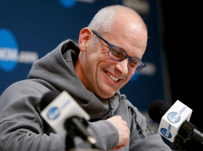 University of Connecticut's new head basketball coach Dan Hurley puts his final touches on the roster.(AP Photo/Keith Srakocic)