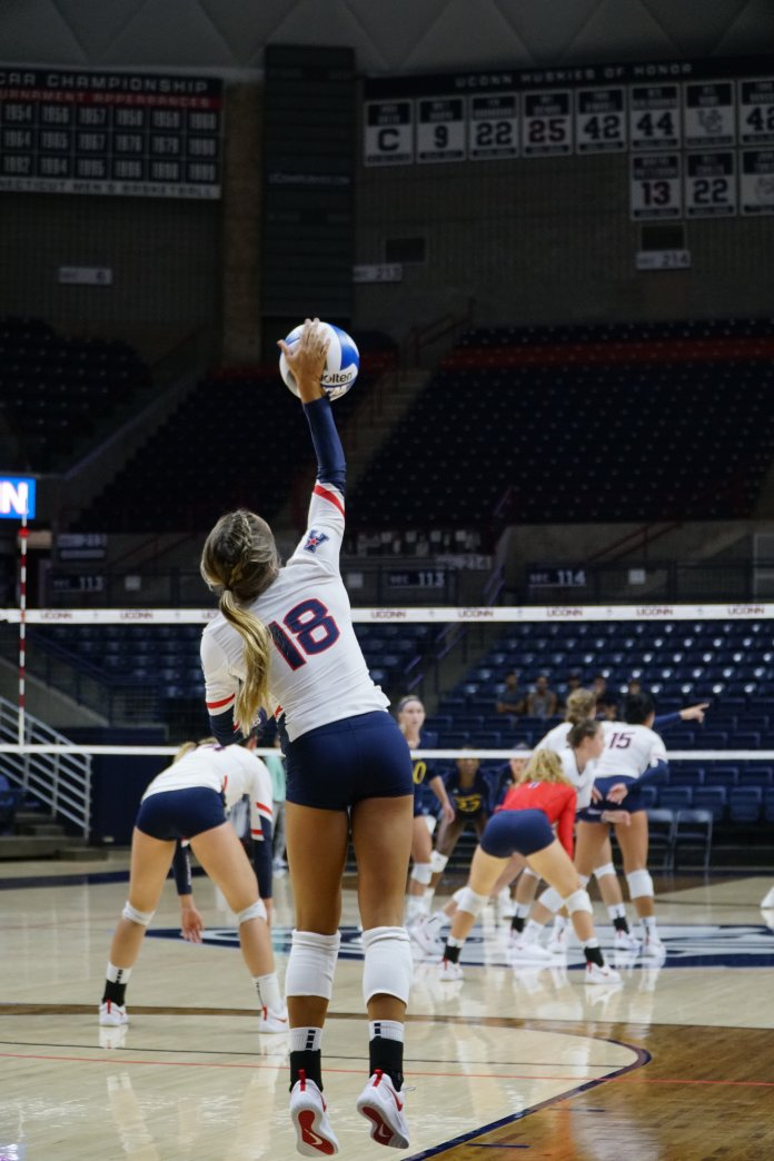 Kennedy Arundel serves the ball during the Huskies Tuesday night game against Quinnipiac on August 28. UConn won 3-0. (Eric Wang/ The Daily Campus)
