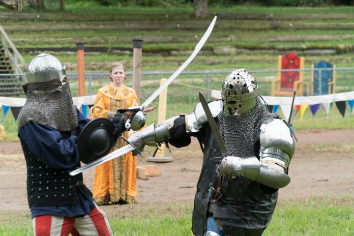 Two knights get medieval at The Connecticut Renaissance Faire. (Eric Wang/ The Daily Campus)