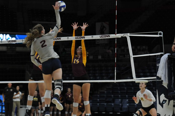 File- Danielle Cabel rises for a spike against Iona on Aug. 31 (Judah Shingleton/ The Daily Campus)
