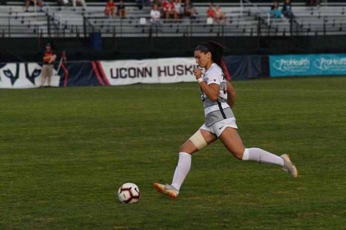 File-UConn's Sophia Danyko-Kulchycky pushes the ball upfield.(Nicholas Hampton/ The Daily Campus)