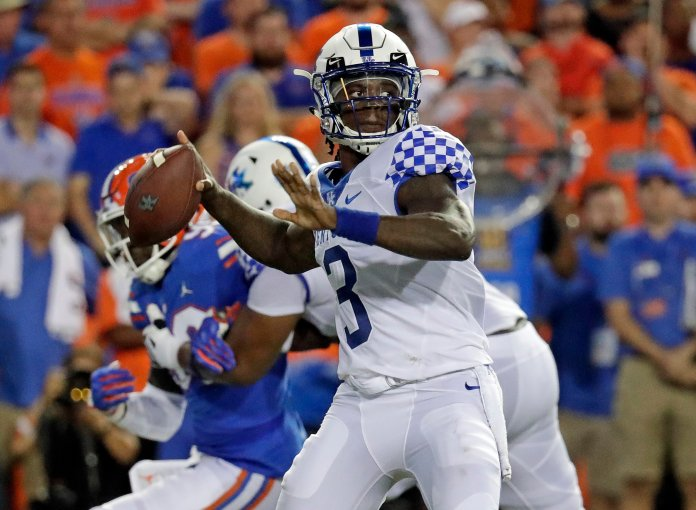 Kentucky quarterback Terry Wilson looks for a receiver during the first half of an NCAA college football game, Saturday, Sept. 8, 2018, in Gainesville, Fla. (AP Photo/John Raoux)
