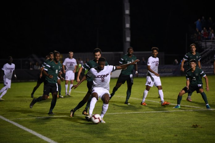 Abdou Mbacke Thiam controls the ball during UConn's game against Dartmouth on Sept. 8. (Charlotte Lao/ The Daily Campus)