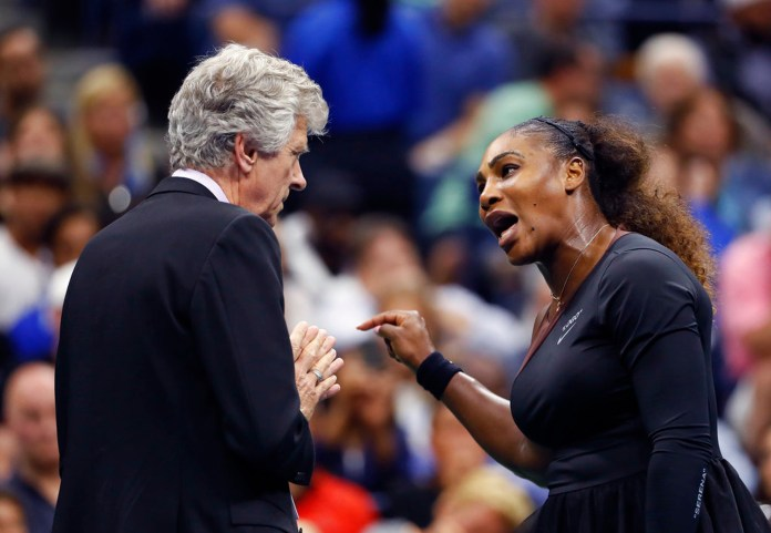 """In this Saturday, Sept. 8, 2018, file photo, Serena Williams, right, talks with referee Brian Earley during the women's final of the U.S. Open tennis tournament against Naomi Osaka, of Japan, in New York. Some black women say Serena Williams' experience at the U.S. Open final resonates with them. They say they are often forced to watch their tone and words in the workplace in ways that men and other women are not. Otherwise, they say, they risk being branded an """"Angry Black Woman."""" (AP Photo/Adam Hunger, File)"""