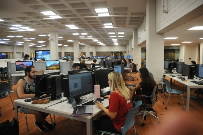 Students can improve how they sit with their technology by having their phone or laptop at a higher level to avoid constantly bending the neck and shoulders, according to the International Journal of Industrial Ergonomics. (Hanaisha Lewis/The Daily Campus)