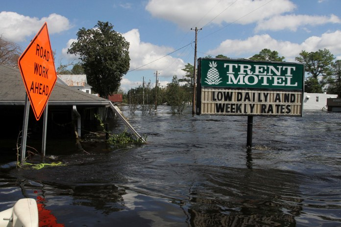 Flooding in the aftermath of Hurricane Florence overtakes the town of Pollocksville, N.C., Tuesday, Sept. 18, 2018. (Gray Whitley/Sun Journal via AP)