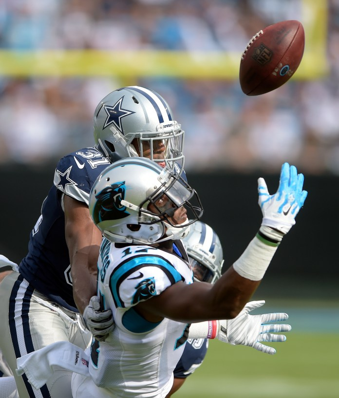 Carolina Panthers' Devin Funchess reaches in vain for a catch as Dallas Cowboys' Byron Jones defends during the first half of an NFL football game in Charlotte, N.C., Sunday, Sept. 9, 2018. (AP Photo/Mike McCarn)