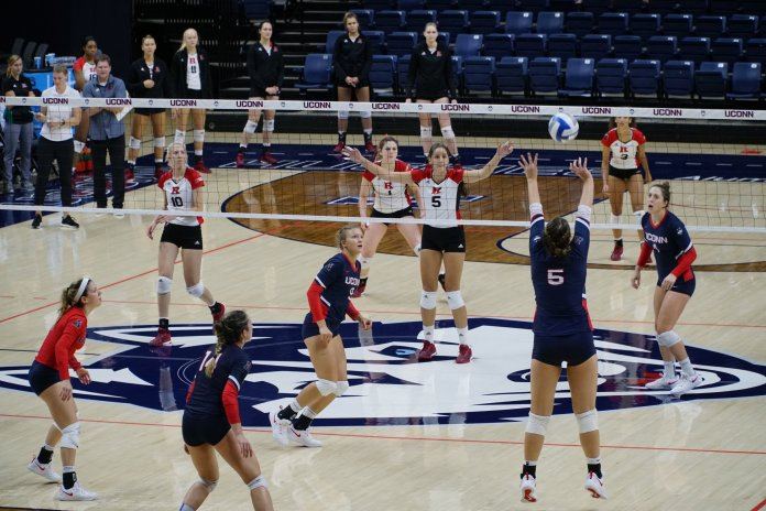 File- UConn Volleyball returns a shot against Rutgers on Sept. 14, 2018. (Eric Wang/ The Daily Campus)