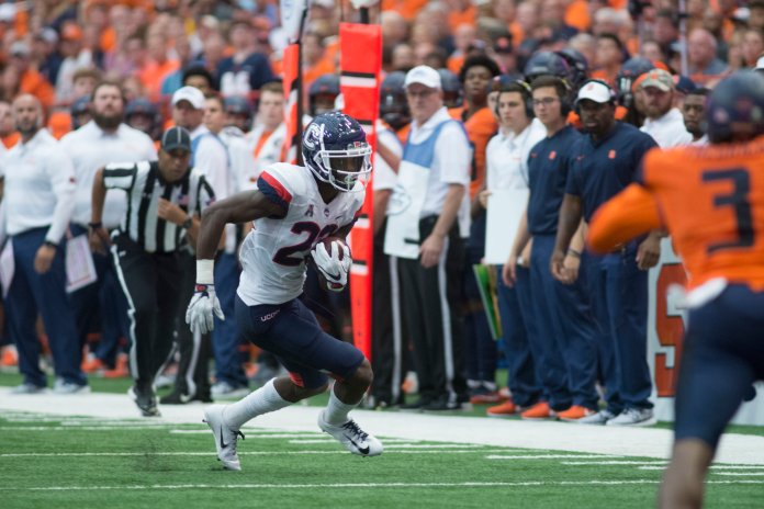 UConn wide receiver Keyion Dixon turns the ball upfield against Syracuse on Sept. 21, 2018. (Eric Wang/ The Daily Campus)