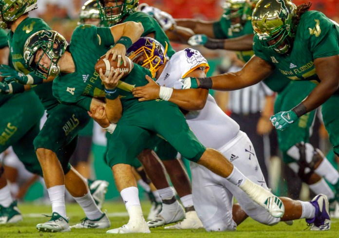 South Florida quarterback Blake Barnett (11) is sacked by East Carolina tight end Johnny Bogle (84) during the first half of an NCAA college football game, Saturday, Sept. 22, 2018 in Tampa, Fla. (Octavio Jones/Tampa Bay Times via AP)