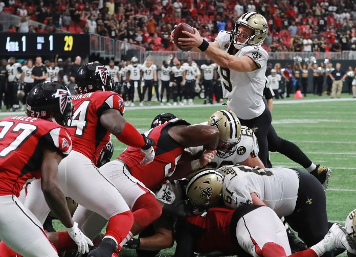 Drew Brees goes over the top for the winning touchdown to beat the Atlanta Falcons 43-37 on Sunday, Sept 23, 2018, in Atlanta. (Curtis Compton/Atlanta Journal-Constitution via AP)