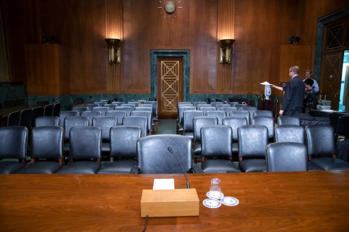 The Senate Judiciary Committee hearing room is prepared for Thursday's planned testimony from Christine Blasey Ford on Capitol Hill in Washington, Wednesday, Sept. 26, 2018. (AP Photo/J. Scott Applewhite)