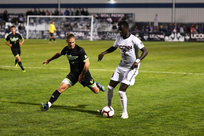 Ibrahima Diop dodges a USF defender during a game on Saturday, Sept. 22 at Morrone Stadium. (Nick Hampton, Associate Photo Editor/The Daily Campus)