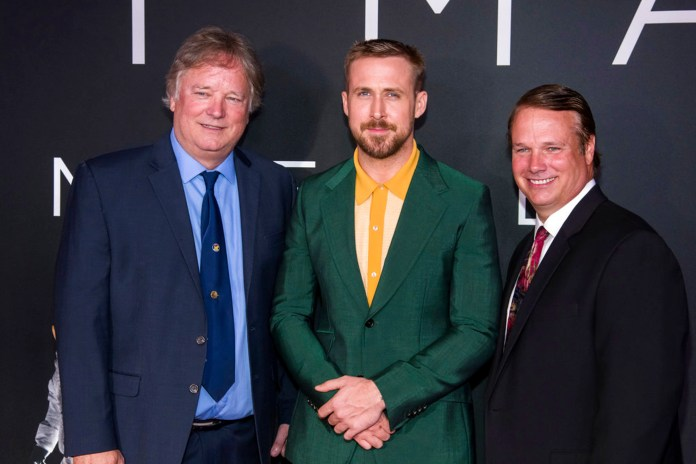 """Rick Armstrong, left, Ryan Gosling and Mark Armstrong attend the """"First Man"""" premiere at the National Air and Space Museum of the Smithsonian Institution on Thursday, Oct. 4, 2018, in Washington. (Photo by Charles Sykes/Invision/AP)"""