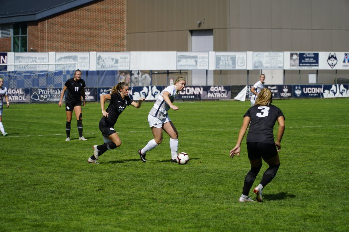 UConn Women's Soccer's Kim Urbanek maintains control of the ball during a game against UCF on Sept. 30, 2018. (Nicholas Hampton/ The Daily Campus)