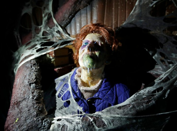"""In this Wednesday, Sept. 12, 2018 photo, the character Barb appears in grand, gory style in the Stranger Things haunted house during Halloween Horror nights at Universal Studios in Orlando, Fla. The """"Stranger Things"""" house is one of 10 haunted houses built for this year's Halloween Horror Nights running through early November. (AP Photo/John Raoux)"""