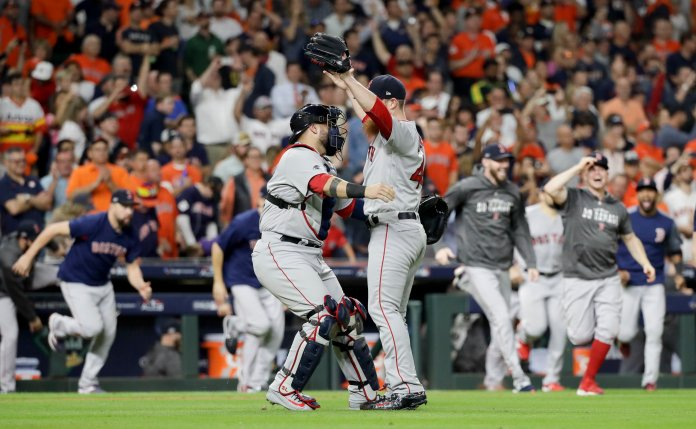 Craig Kimbrel celebrates with catcher Sandy Leon after winning the baseball American League Championship Series against the Houston Astros. (AP Photo/David J. Phillip)