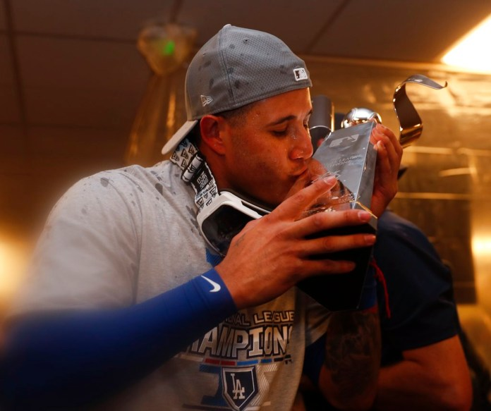 Los Angeles Dodgers' Manny Machado celebrates after Game 7 of the National League Championship Series baseball game against the Milwaukee Brewers Saturday, Oct. 20, 2018, in Milwaukee. The Dodgers won 5-1 to advance to the World Series. (AP Photo/Jeff Roberson)