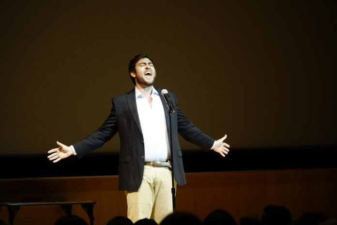 A contestant in the Homecoming Royalty Pageant performs his talent with the goal of earning the title of Homecoming King. (Eric Wang, Staff Photographer/The Daily Campus)