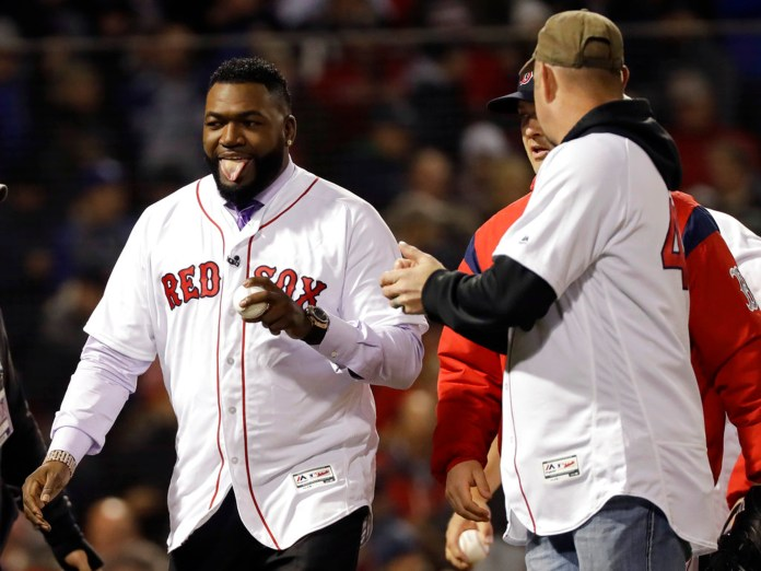 Former Boston Red Sox Bobby Ortiz walks with former Red Sox players after throwing out the ceremonial first pitch before Game 2 of the World Series baseball game against the Los Angeles Dodgers and Boston Red Sox Wednesday, Oct. 24, 2018, in Boston. (AP Photo/David J. Phillip)