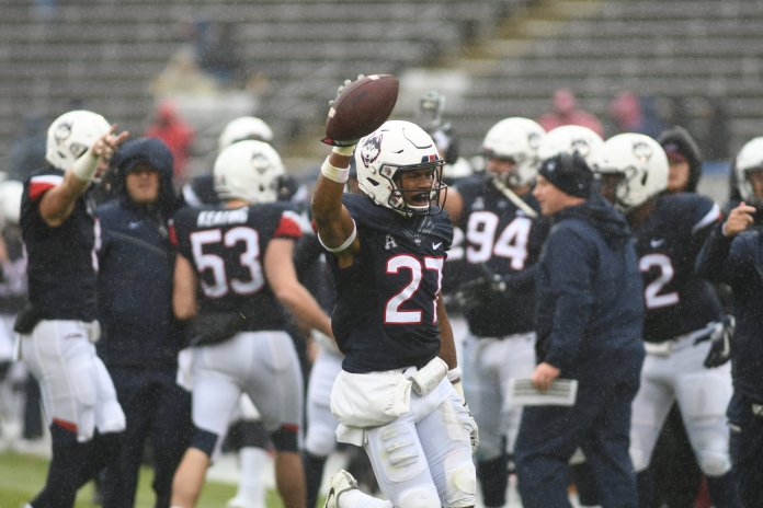 Linebacker Omar Fortt celebrates with the football. UConn lost to UMass Saturday in a tight game. (Charlotte Lao, Photo Editor/The Daily Campus)