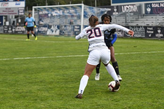 Senior forward Elena Santos attacks a Tulsa defender on Senior Day (Eric Wang/The Daily Campus)