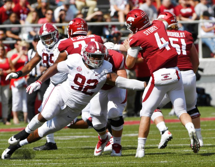 """FILE - In this Oct. 6, 2018, file photo, Alabama defensive lineman Quinnen Williams puts the pressure on Arkansas quarterback Ty Storey in the second half of an NCAA college football game, in Fayetteville, Ark. The guys who have to block Quinnen Williams in practice aren't the least bit surprised by his success on Alabama's defensive line. Williams has emerged as a dominant force for the top-ranked Crimson Tide at nose guard, doing in games what he has often done in practice. """"I think we're honestly a little relieved as an (offensive) line that we're like, 'OK, no one else can block him either,'"""" Alabama left tackle Jonah Williams said. (AP Photo/Michael Woods, File)"""