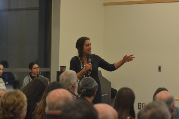 """Winona LaDuke, an American environmentalist, economist, and writer, spoke in Werth Tower Thursday afternoon about her experiences with a Native American background. She spoke about her people's view of places as """"sacred land"""" and how hard she has fought to keep pipelines from corrupting the reservations in North America. (Photo by Nicholas Hampton/The Daily Campus)"""