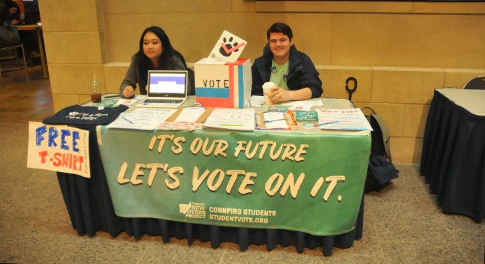 UConn Pirg is tabling in the Student Union to promote the elections. (Hanaisha Lewis/The Daily Campus)