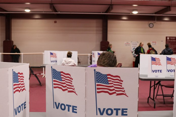 The officials calculated a total of 3,421 ballots for Mansfield Community Center. (Maggie Chafouleas/The Daily Campus)