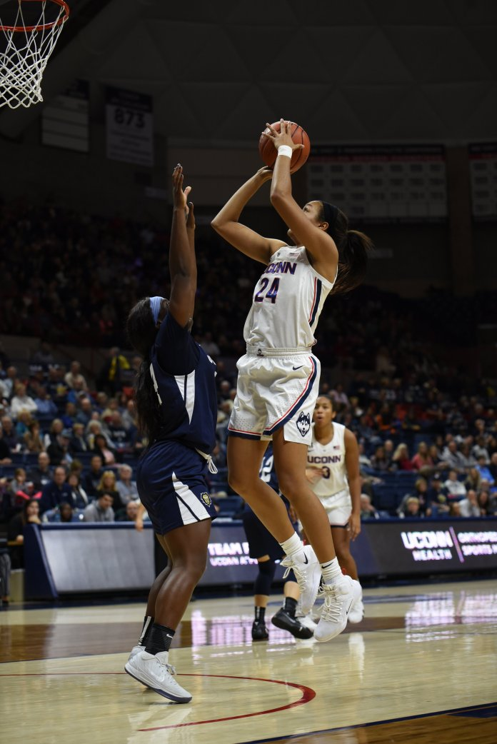 Napeesha Collier takes it to the rack during their exhibition game against Vanguard on November 4. (Charlotte Lao/ The Daily Campus)