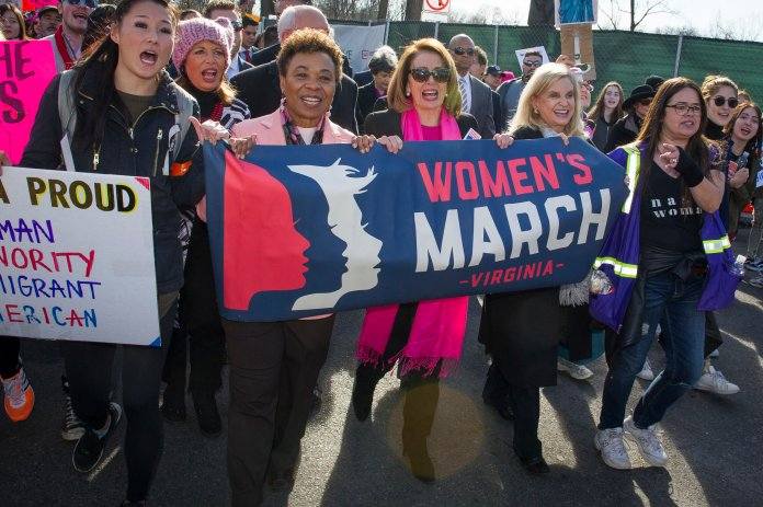 In this Jan. 20, 2018 file photo, House Minority Leader Nancy Pelosi of Calif, center, marches in the Women's March as they walk to the White House from the Lincoln Memorial in Washington. (Cliff Owen/AP)