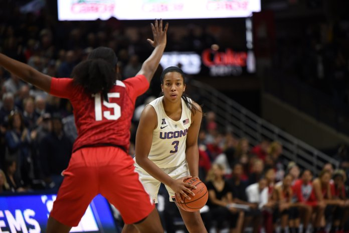 Megan Walker faces an Ohio State defender during a game on Sunday, Nov. 11 at Gampel Pavilion. The Huskies defeated the Buckeyes 85-53. (Charlotte Lao, Photo Editor/The Daily Campus)