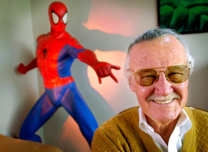 """FILE - In this April 16, 2002, file photo, Stan Lee, 79, creator of comic-book franchises such as """"Spider-Man,"""" """"The Incredible Hulk"""" and """"X-Men,"""" smiles during a photo session in his office in Santa Monica, Calif. Comic book genius Lee, the architect of the contemporary comic book, has died. He was 95. (AP Photo/Reed Saxon, File)"""