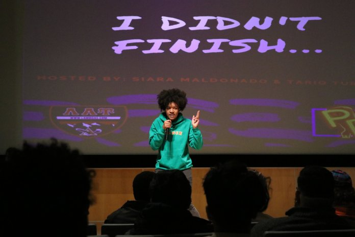 """Participants of an event named """"I Didn't Finish..."""" sing, dance, and compete in a poetry slam in the Student Union Theater on Tuesday night. The event was sponsored by Poetic Release and Lambda Alpha Upsilon fraternity. (Photo by Maggie Chafouleas/The Daily Campus)"""