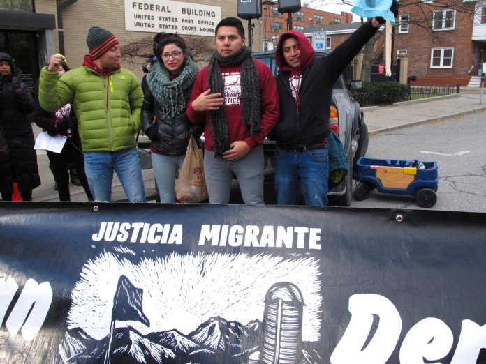 Members of the advocacy group Migrant Justice stand before the federal court in Burlington, Vt., on Wednesday, Nov. 14, 2018. They filed a lawsuit against the Department of Homeland Security, Immigration and Customs Enforcement and the Vermont Department of Motor Vehicles alleging that ICE targeted and arrested members in retaliation for their activism. (AP Photo/Lisa Rathke)