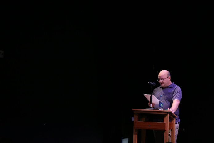 (Leigh Grossman reads his book at Barnes & Noble Nov.14. Leigh Grossman is a writer , college lecturer, editor, and publishing consultant, also teaches in the english Department at the university of Connecticut. (Congyang An/The Daily Campus)